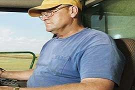 Man driving farm machinery