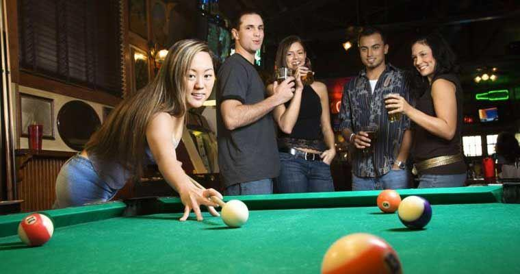 Friends playing eight ball