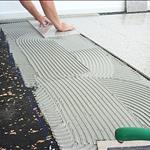 AcoustaMat acoustic underlay installation under tiles